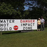 Ralph Jack and Gwyneth Boutilier live on Cumminger Lake, below the proposed Cochrane Hill mine site, so they make their feelings about gold mining known on their front lawn.