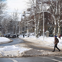 When it snows, the part of the road that cars actually use is exposed—and a lot more space for pedestrians, too.