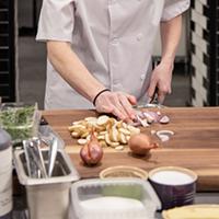 Stephanie Ogilvie, seen here on the Top Chef Canada set, says east coast chefs work harder.