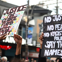 Signs at the June 2 Halifax protest for George Floyd, whose death at the hands of Minneapolis police has four officers charged with murder.