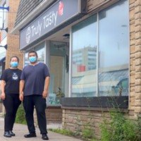 Shanshan Liu and Jian Li stand outside their new, bigger Truly Tasty, which is set to open Oct 23.