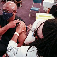 Nurse Carolyne Aremo vaccinates Eugene Anderson at the first ANS community clinic in Upper Hammonds Plains on April 8. COMMUNICATIONS NOVA SCOTIA