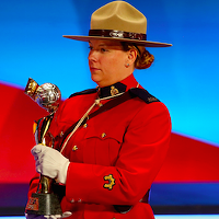 The FIFA Woman`s World Cup trophy is carried by an RCMP officer during an event last year in Ottawa. Mountie at the draw in Ottawa.
