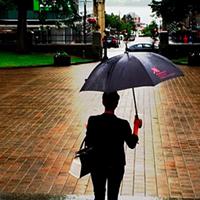 Amanda Forrest, principal designer for The Marilyn Denis Show tours Grande Parade in the rain.