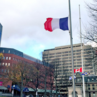 The French flag flies at half-mast in front of City Hall last week.