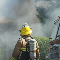 A Halifax Regional Fire and Emergency service firefighter monitors the progress on the scene of a stubborn house fire in 2012.