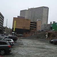 Undead development agreements and horrific legal oversights have left this downtown lot barren since 2004.