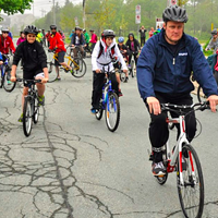 Mike Savage leading the pack on a drizzly mayor's bike ride on June 10.