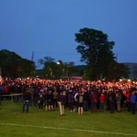 Candles raised during Monday's vigil.