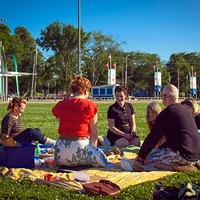 Art and food lovers gather on the Common for an Eyelevel picnic last week.