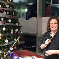 Radio broadcaster Lisa Blackburn pictured here with a non-robotic Christmas tree.