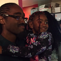 Lindell Smith poses with his daughter while watching the election results come in.