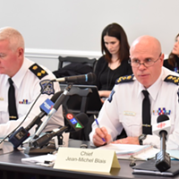 Police chief Jean-Michel Blais (right) and deputy chief Bill Moore address the board of police commissioners last week.