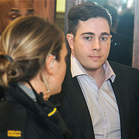 Christopher Garnier being escorted from court, in 2016.