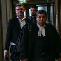 Defence lawyers Eugene Tan (front) and Brad Sarson walk into court on May 24.