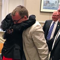 Councillor Waye Mason hugs Mi'kmaw Native Friendship Centre executive director Pam Glode-Desrochers