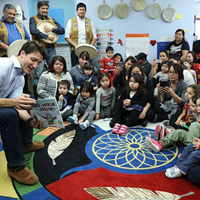 Prime minister Justin Trudeau speaks to children at the N'dilo Aboriginal Head Start program in the Northwest Territories.