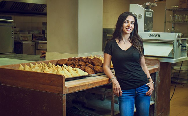 Fran Shirazi has been selling over-sized, golden samosas for 14 years. - LENNY MULLINS