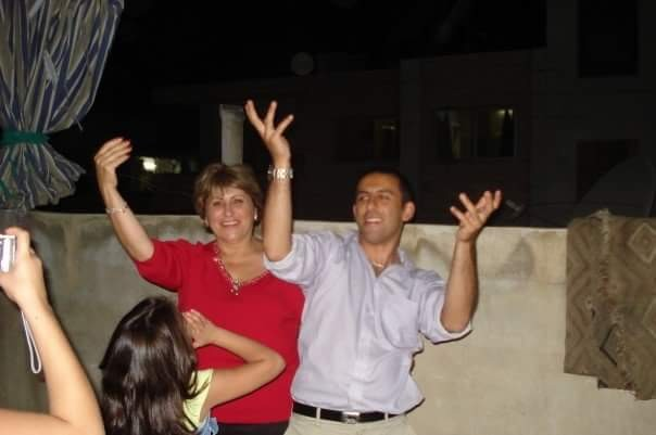 Andrew and Rajaa Al-Khouri dance on a rooftop in Syria - SUBMITTED