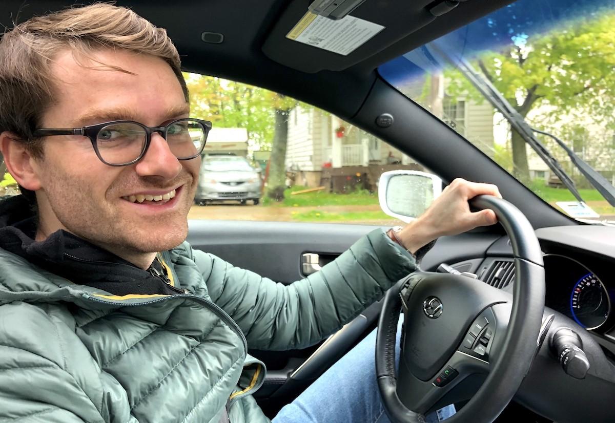 Cedric Mathieu, managing director of Turo Canada, behind the wheel of Elle's car. - THE COAST