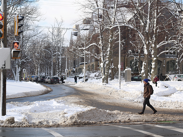 When it snows, the part of the road that cars actually use is exposed—and a lot more space for pedestrians, too. - VICTORIA WALTON