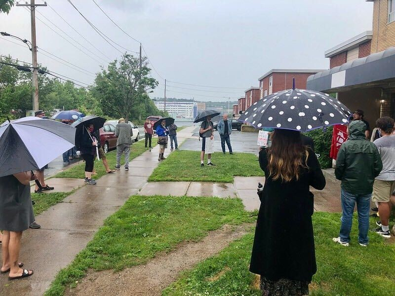 Tenants and organizers outside of 6 Nivens Avenue on July 14. - FELESHIA CHANDLER
