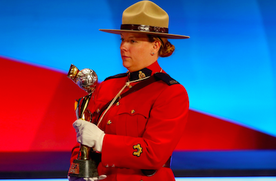 The FIFA Woman`s World Cup trophy is carried by an RCMP officer during an event last year in Ottawa. Mountie at the draw in Ottawa. - ALEXANDER HASSENSTEIN, FIFA