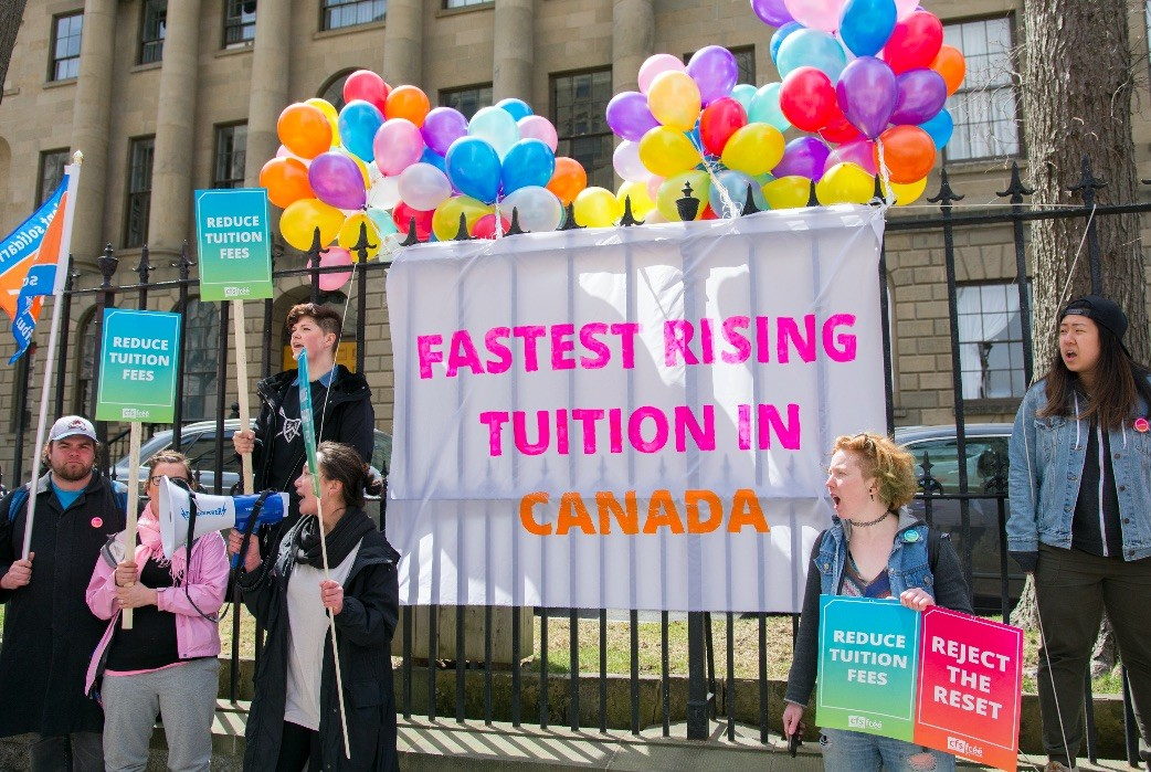 Students protest tuition costs outside the Legislature. - PATRICK FULGENCIO