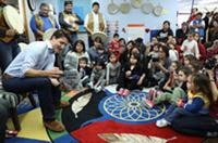 Prime minister Justin Trudeau speaks to children at the N'dilo Aboriginal Head Start program in the Northwest Territories.