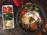 A banchan trio and hot stone bibimbap