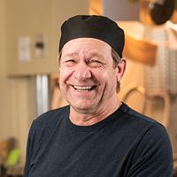 Eldon Turner serves turkey dinner, and good company