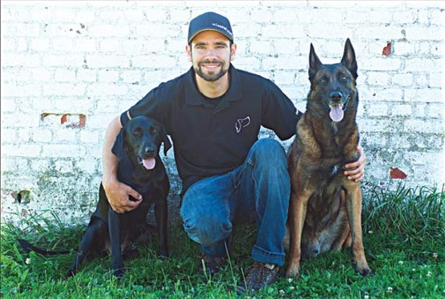 Unleashed Potential's Ted Efthymiadis and two furry friends.