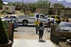 A Pinal County Sheriff truck drives by as the Guerrero, Acedo and Serrano families evacuate from Luz Acedo's home in Hereford, Ariz. on Sunday, June 19. The Guerrero and Serrano families were evacuated days before. They have since returned to their homes.