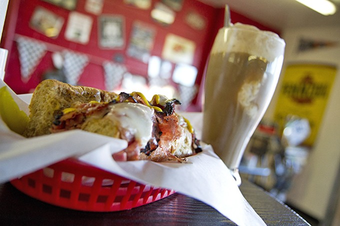A Pit Stop Pastrami on rye with baked-potato salad and a root beer float at the Hot Rod Café.