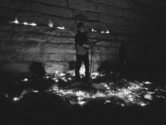 Adam Torres plays under the bridge at a secret SXSW show. - CAL FABER