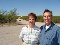 """MARI HERRERAS - Cathy Hufault; with husband, John: """"We want to help them understand the importance of this situation. If waiting 30 days helps, then we are happy to wait 30 days."""""""