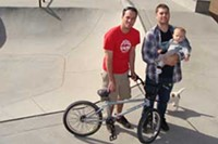 MARI HERRERAS - Chris Miracle and Mike Hines, holding his 9-month-old son, Elliot, want the city of Tucson to allow BMX bikes at the yet-to-be opened Albert Gallego Skate Park.