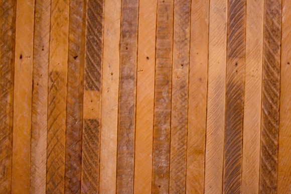 Reclaimed wood from the building gives it a historic, authentic touch. - HEATHER HOCH