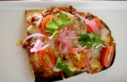 Flatbread with chorizo and Oaxaca cheese. - HEATHER HOCH