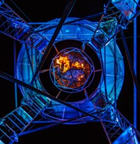 KATHLEEN DREIER - From All Souls Procession 2013, a view of the urn, the remembrances and messages burning, from below the scaffolding.