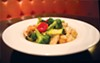 Happy Family dish with chicken, shrimp, scallops and crab meat served with vegetables from An Del Sol.