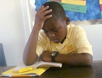 MARI HERRERAS - Imago Dei fifth-grader Mohamed Kasimu reads during quiet time - after lunch.