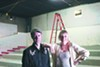 Jeff Yanc, program director at the Loft, and Peggy Johnson, executive director, stand in the under-construction theater.
