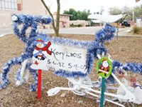 MARI HERRERAS - Kory Laos' ghost bike near the intersection of Speedway Boulevard and Euclid Avenue. In 2007, Laos died after being struck by a car while riding his BMX bicycle near the UA.