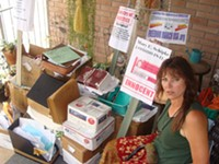 MARI HERRERAS - Mary Elizabeth Schipke sits with the dozen boxes that represent - her ongoing legal skirmish with the federal government since she was - convicted and labeled a terrorist more than four years ago.