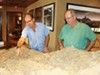 Stephen Phinny and Saguaro Ranch director of sales Mike Conlin point out details on a 3-D model of the property that takes center stage in the company's sales office.
