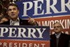 Texas Governor Rick Perry appears with Arizona's Maricopa County Sheriff Joe Arpaio at the Main Street Cafe in Council Bluffs, Iowa on Tuesday, December 27, 2011.