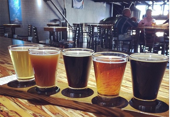 This flight of Mike Hess brews is like a beer rainbow. - HEATHER HOCH