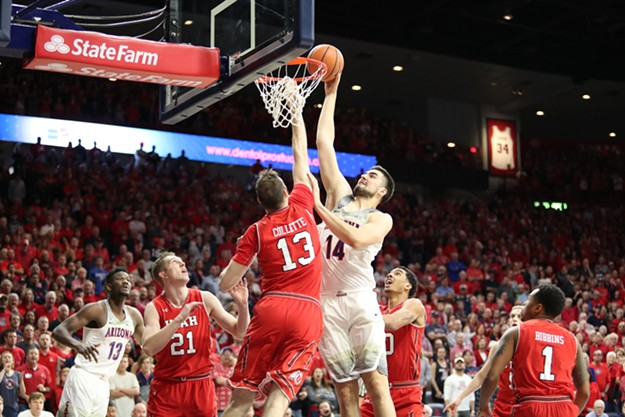 Senior center Dusan Ristic dunks on Utah's David Collette in a January game. - ARIZONA ATHLETICS