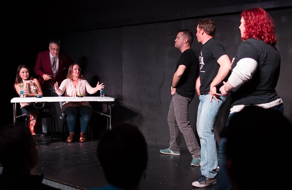 Contestants Kristal Pino and Tina Jennings, left with host Kurt Lueders, try to guess clues acted out by improvisers, left to right, Jordan Wilson, Corey Jenks and Jessica Stapp in TIM's Game Show Show. - JEREMY SHOCKLEY